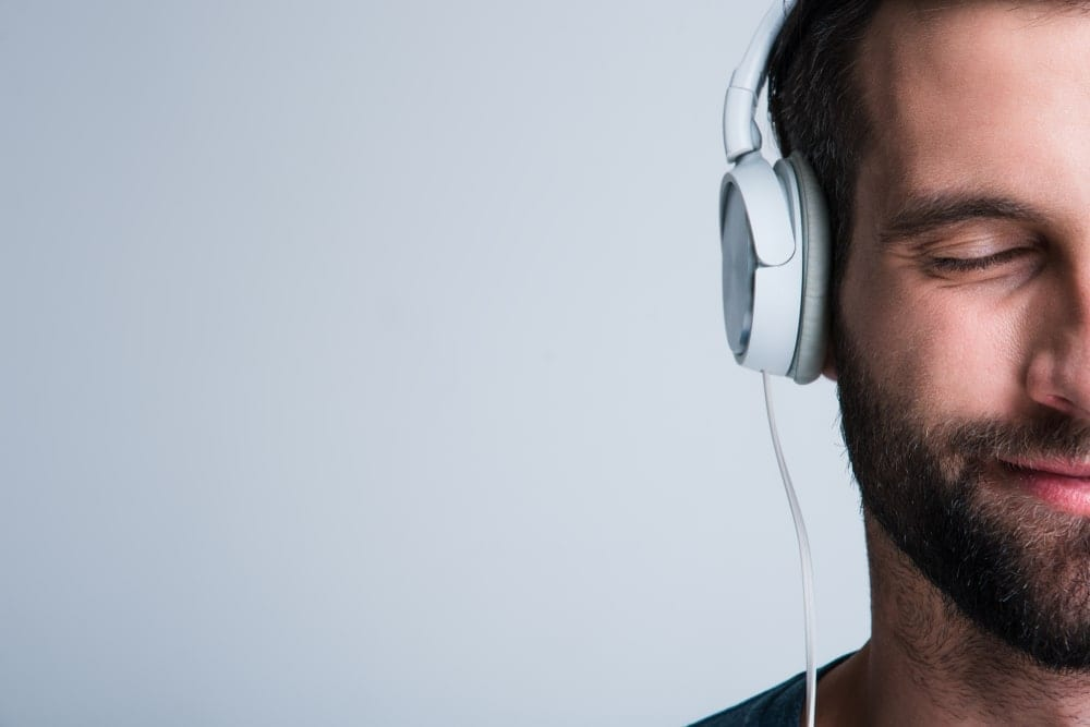 Man off to the right side of the frame wearing headphones